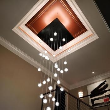 multiple lightbulbs hanging from ceiling